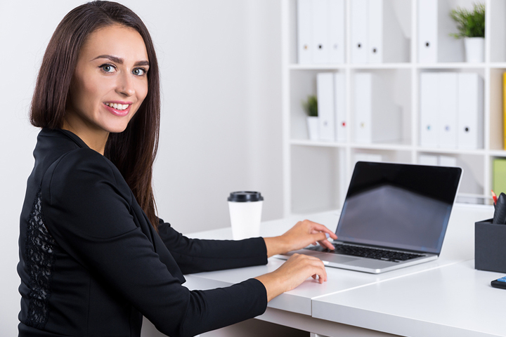 Young lady preparing to use her computer